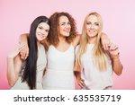 three happy friends women at... | Shutterstock . vector #635535719