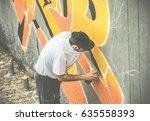 Graffiti Artist Covering His...