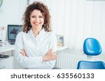 portrait of female dentist. she ... | Shutterstock . vector #635560133