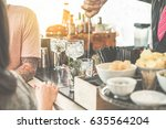 bartender serving cocktail in... | Shutterstock . vector #635564204