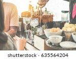 bartender serving cocktail in... | Shutterstock . vector #635564204