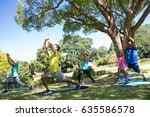 group of people performing yoga ... | Shutterstock . vector #635586578