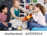 little preschool girl holding... | Shutterstock . vector #635590514
