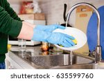 Hands Cleaning Dirty Dishes In...
