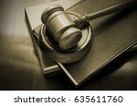 wooden gavel and legal books on
