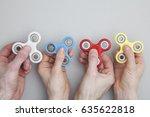 hands holding popular fidget...