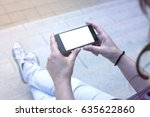 woman holding modern smartphone.... | Shutterstock . vector #635622860