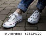 woman in sneakers on the street ... | Shutterstock . vector #635624120