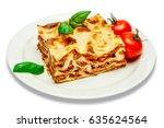 portion of tasty lasagna...   Shutterstock . vector #635624564