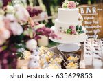 White Wedding Cake Decorated B...
