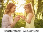 mother with her daughter... | Shutterstock . vector #635634020