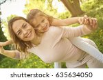 mother and daughter outdoors in ... | Shutterstock . vector #635634050