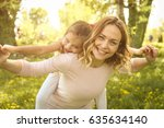 mother and daughter outdoors in ... | Shutterstock . vector #635634140