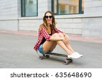 young woman sitting on the... | Shutterstock . vector #635648690