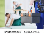 worker is keeping a toolbox and ... | Shutterstock . vector #635666918