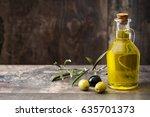 virgin olive oil in a crystal... | Shutterstock . vector #635701373
