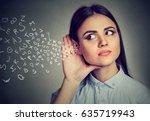 woman holds her hand near ear... | Shutterstock . vector #635719943