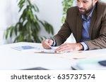 close up of businessman working ... | Shutterstock . vector #635737574