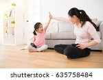 young casual mom accompany cute ... | Shutterstock . vector #635758484