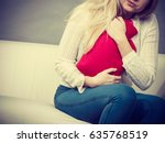 painful periods and menstrual... | Shutterstock . vector #635768519