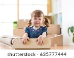 just moved into a new home. kid ... | Shutterstock . vector #635777444