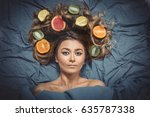 Small photo of Beautiful gorgeous model girl with colorful citrus healthy fruits in her shiny hair. Care and hair products. Hair care concept. Hair nutrition. Attractive girl with fruits. Natural beauty. Skin care.