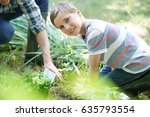 father teaching son how to... | Shutterstock . vector #635793554