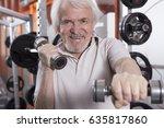 attractive senior man in gym... | Shutterstock . vector #635817860