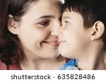 mother and son looking each... | Shutterstock . vector #635828486