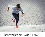 Young Man Doing Workout At The...
