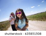 beautiful girl and sister with... | Shutterstock . vector #635851508
