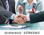 estate agent shaking hands with ... | Shutterstock . vector #635863463