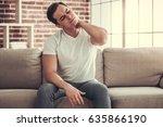 feeling pain in neck. handsome... | Shutterstock . vector #635866190