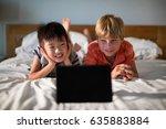 smiling siblings looking at... | Shutterstock . vector #635883884