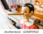 Small photo of VIENNA, AUSTRIA, MARCH 23, 2017: wooden pinocchio doll with his long nose at the souvenir shop