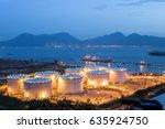 oil tanks at night | Shutterstock . vector #635924750