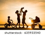 silhouettes of parents walk... | Shutterstock . vector #635933540