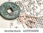 acupuncture needles and ancient ... | Shutterstock . vector #635954000
