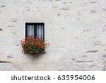 window with red geranium flower | Shutterstock . vector #635954006