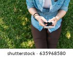 young asian woman using smart... | Shutterstock . vector #635968580