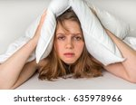 young woman in bed covering... | Shutterstock . vector #635978966