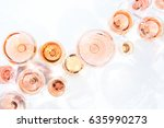 many glasses of rose wine at... | Shutterstock . vector #635990273
