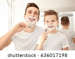 father and son shaving in... | Shutterstock . vector #636017198