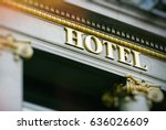 sun flare above hotel word with ... | Shutterstock . vector #636026609