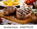 grilled beefsteaks on cutting... | Shutterstock . vector #636070139