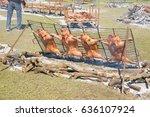 roasting suckling pigs | Shutterstock . vector #636107924