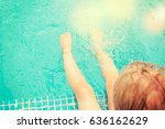 baby sitting near swimming pool. | Shutterstock . vector #636162629