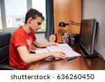 teenager boy doing homework on... | Shutterstock . vector #636260450