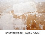 color splashes on brown paper - stock photo