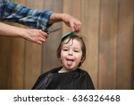 a little boy is trimmed in the... | Shutterstock . vector #636326468